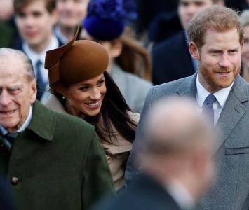 El príncipe Harry, el Príncipe Felipe y Meghan Markle
